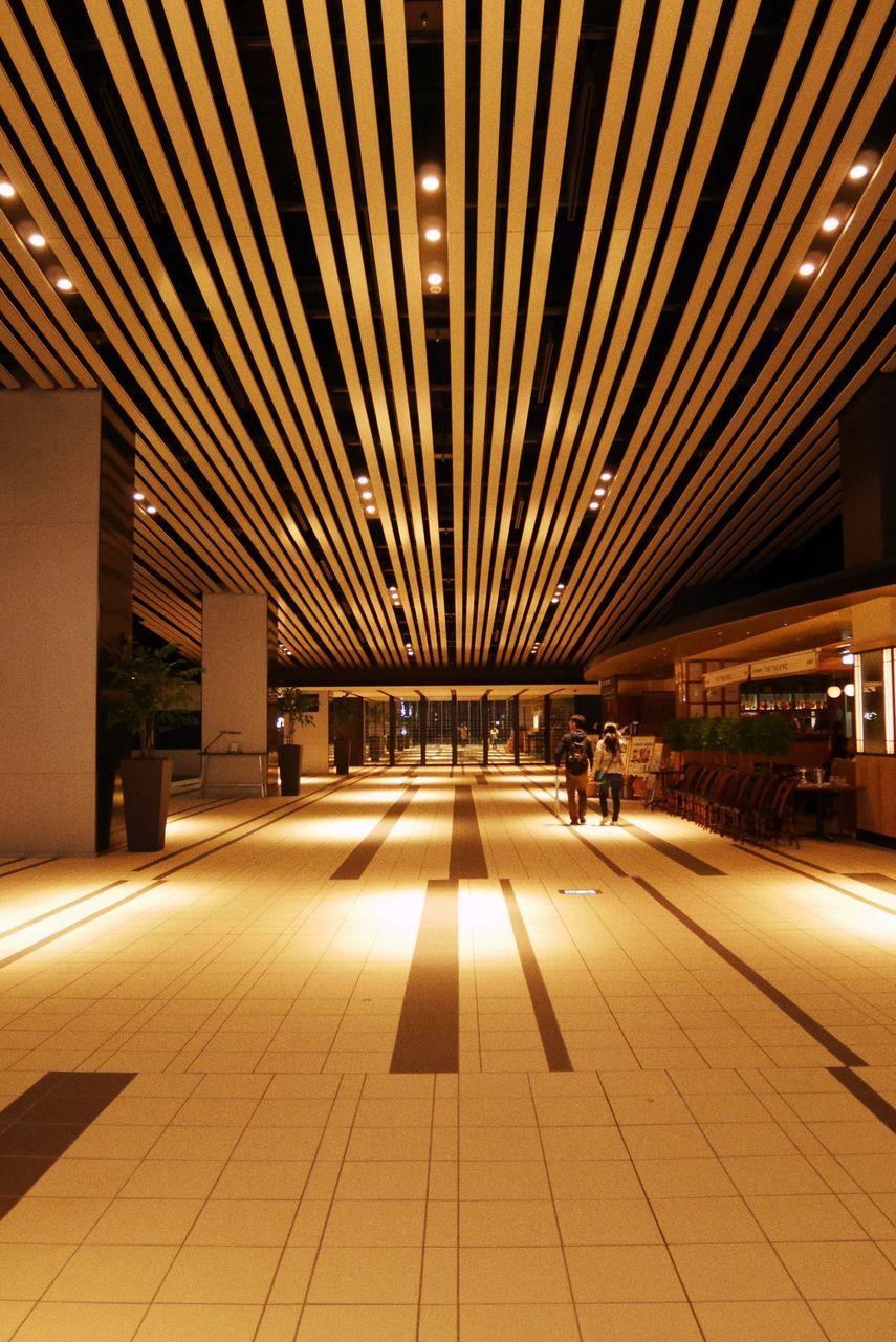illuminated, indoors, night, transportation, railroad station, railroad station platform, built structure, architecture, no people