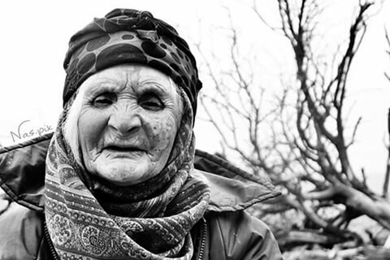 senior adult, wrinkled, adult, adults only, portrait, senior women, one person, human face, people, winter, women, looking at camera, cold temperature, headshot, outdoors, human body part, smiling, men, real people, only men, warm clothing, close-up, day, sky