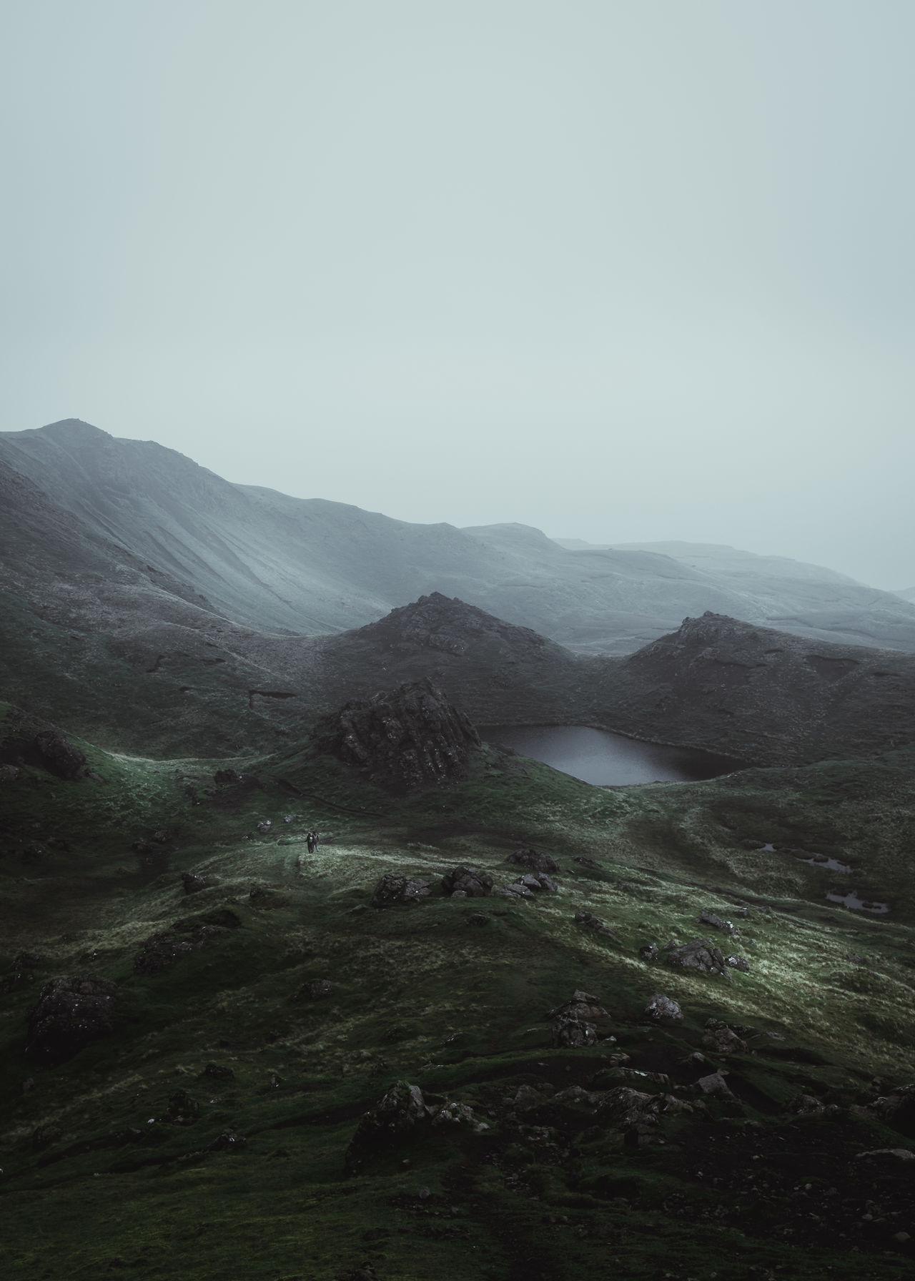 Never stop exploring. Location: Isle Of Skye, Scotland Equipment: Fujifilm X-T1 + XF18-55 Atmosphere Beauty In Nature Day Green Hiker Hill Isle Of Skye Lake Landscape Mood Moody Mountain Nature No People Old Man Of Storr Outdoor Outdoors Scenics Schottland Scotland Sky Skye Slope Tranquil Scene Wanderlust