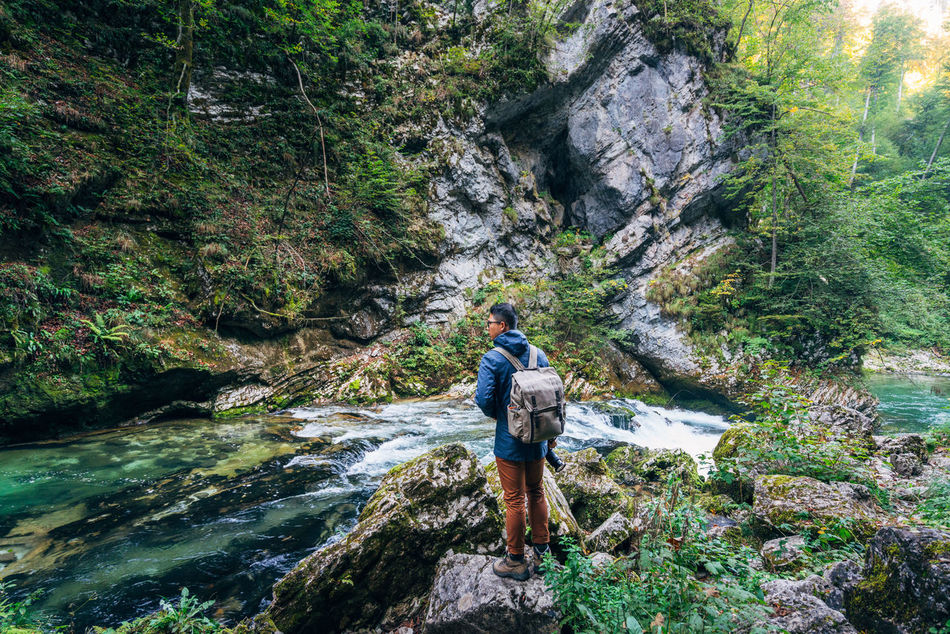 Adult Adults Only Adventure Beauty In Nature Canyon Day Eco Tourism Exploration Forest Full Length Hiking Nature One Man Only One Person Only Men Outdoors People Rock - Object Scenics Stream - Flowing Water Vacations Water Waterfall Young Adult