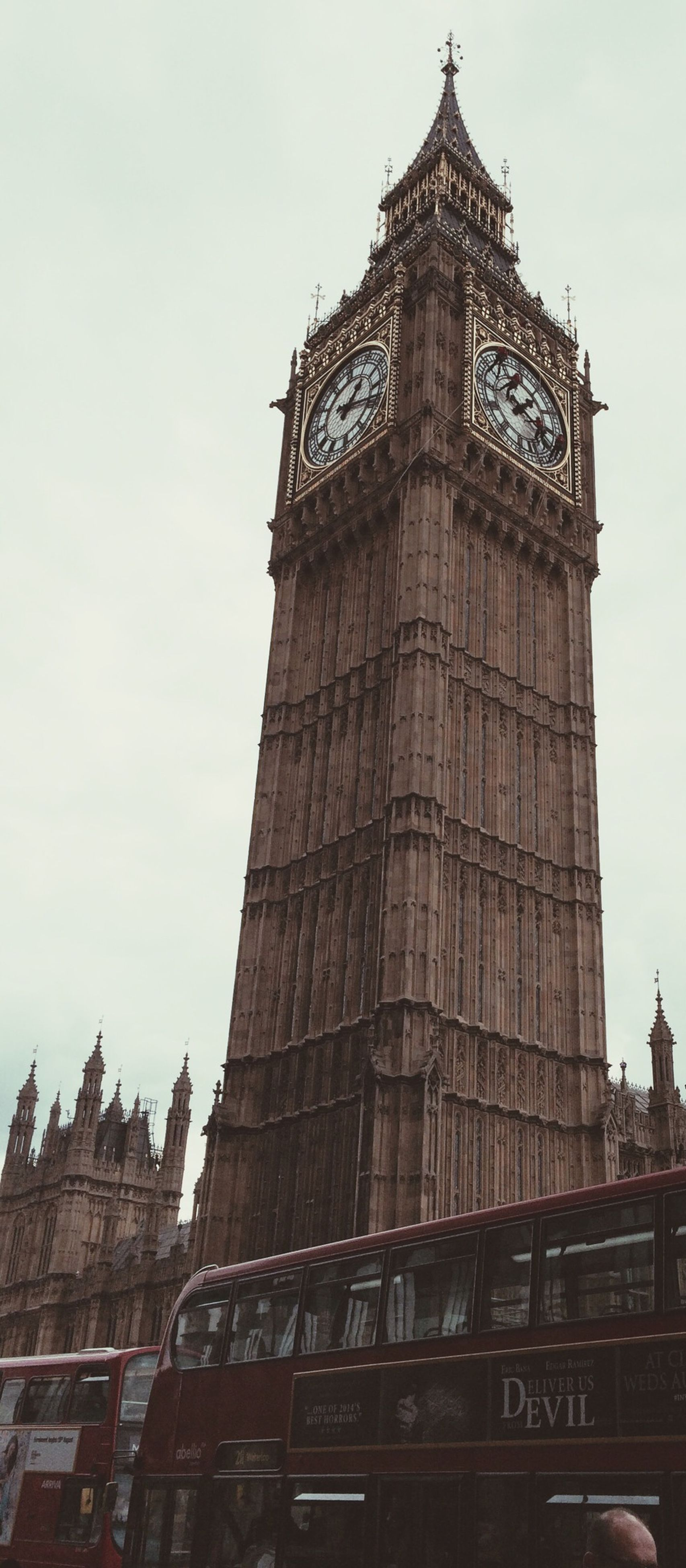 architecture, built structure, building exterior, low angle view, tower, famous place, travel destinations, clock tower, tall - high, international landmark, tourism, capital cities, travel, clear sky, history, city, religion, big ben, sky, place of worship