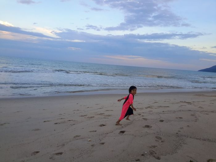 Boy Running Boy Beach Sand Sea Full Length People Red One Person Sky Running