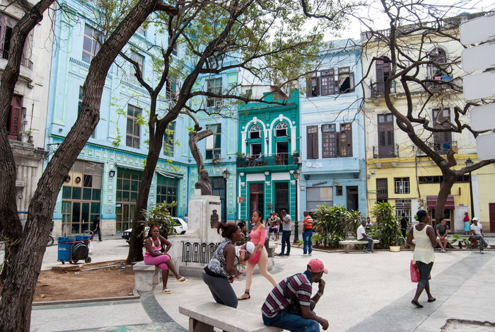 Architecture Building Building Exterior Photography In Motion City City Life Cuba Day Full Length Havana Incidental People Large Group Of People Lifestyles People Photography Public Square Real People Residential Building Cuba Collection Street Street Photography Sunlight Tree Walking