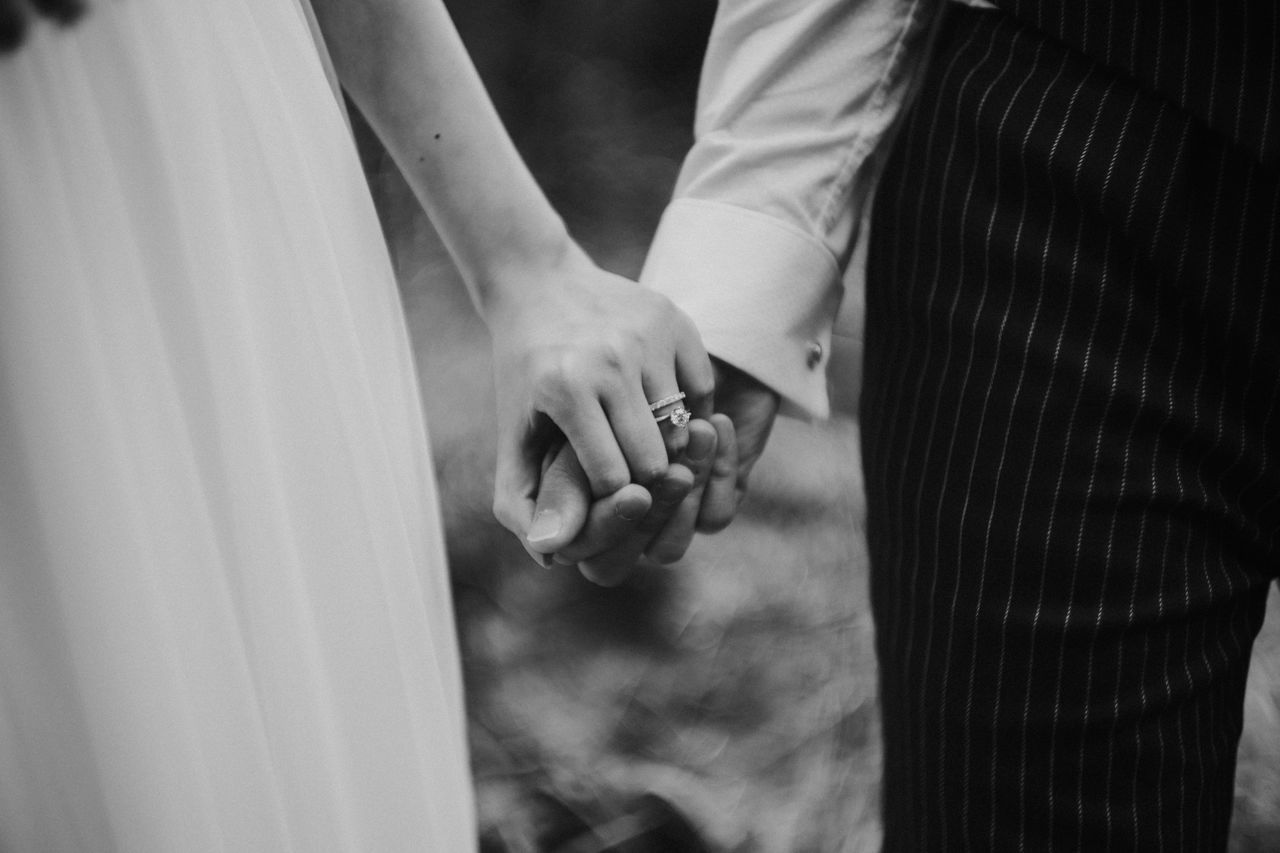 Bonding Bride Bridegroom Celebration Celebration Event Ceremony Close-up Day Focus On Foreground Groom Human Hand Life Events Love Men Midsection Outdoors Real People Religion Togetherness Two People Wedding Wedding Ceremony Wedding Dress Wedding Ring Women