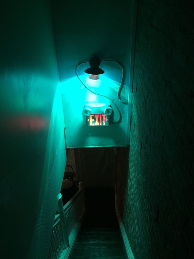 Absence Blue Built Structure Corridor Dark Diminishing Perspective Electric Lamp Electric Light Empty Exit Exit Sign Glowing Illuminated Light Lighting Equipment Lit Narrow Night No People The Way Forward Walkway