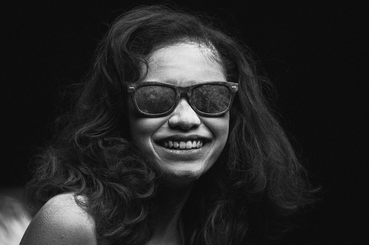 Black Background Close-up Day Eyeglasses  Front View Headshot Indoors  Lifestyles Long Hair Looking At Camera One Person People Portrait Real People Studio Shot Sunglasses The Portraitist - 2017 EyeEm Awards Young Adult Young Women