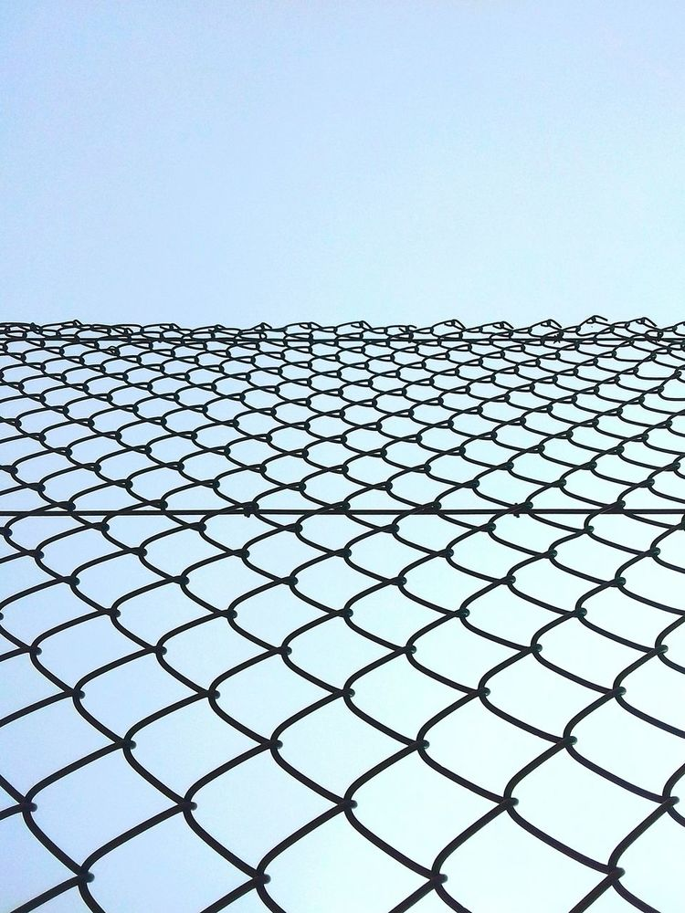 Outdoors Day No People Clear Sky Sky Nature Metal Close-up Grille Grillage Perspective Liberté Noliberty