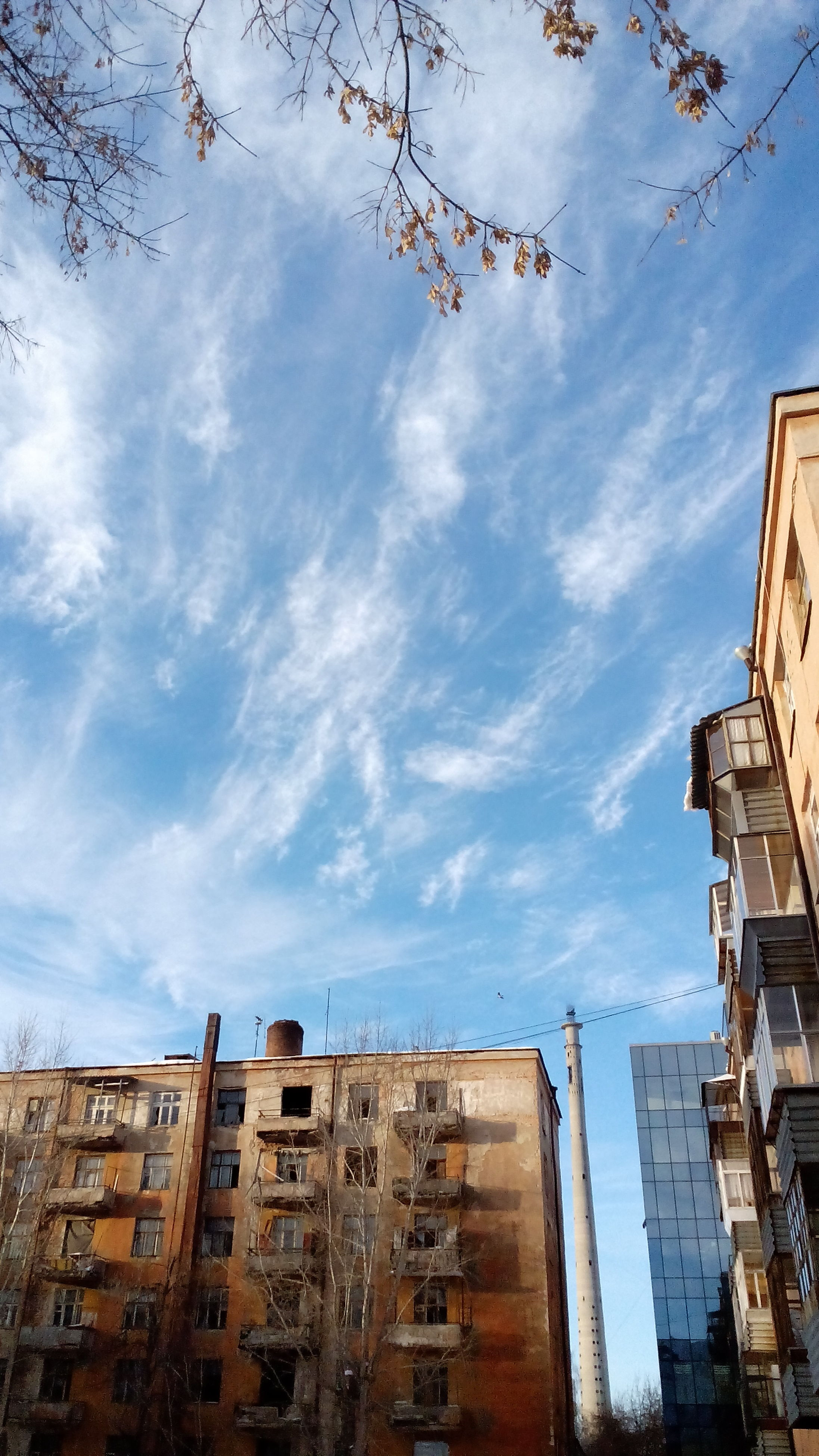 building exterior, architecture, built structure, low angle view, sky, city, building, residential building, cloud - sky, residential structure, window, cloud, day, outdoors, cloudy, no people, apartment, house, blue, residential district