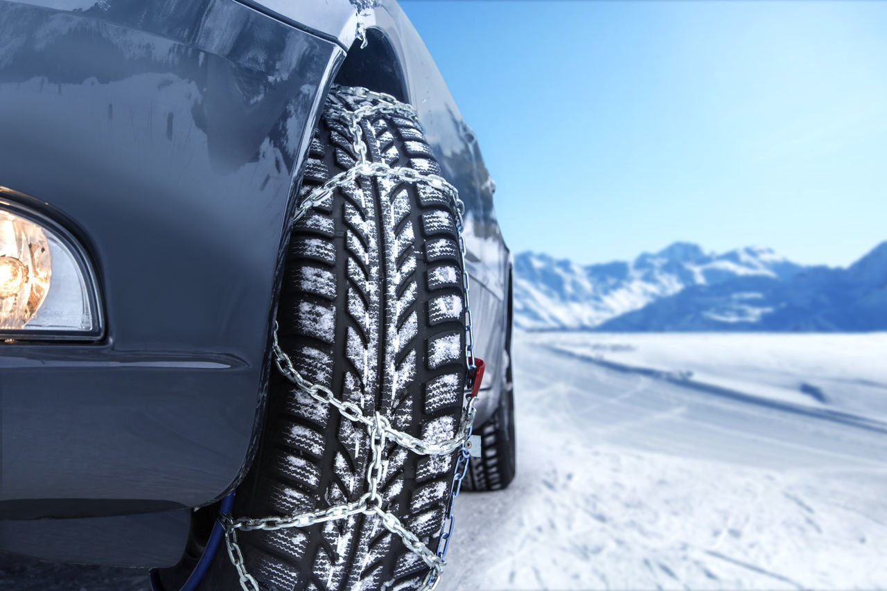 Car with mounted snow chains in wintry environment Frozen Weather Wintertime Car Chains Close-up Cold Temperature Conditions Day Land Vehicle Mode Of Transport Nature No People Outdoors Snow Snowing Tire Transportation Winter Winter Time