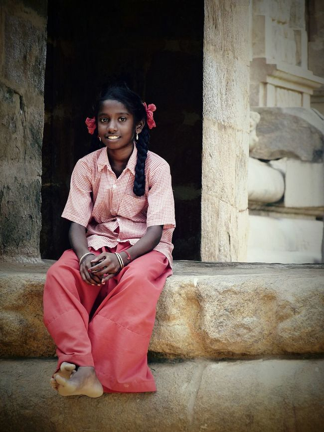 The Color Of School Tamilnadu School Uniform School Uniforms Around The World Afterschool  Portrait Child Photography Child Portrait Child Tamilgirl Full Length Sitting In Front Of Young Adult Casual Clothing Front View Red History Person Day Entrance Outdoors Confidence