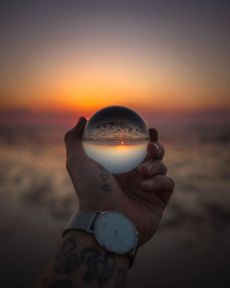 Sunset Human Hand One Person Human Body Part Sky Holding Focus On Foreground