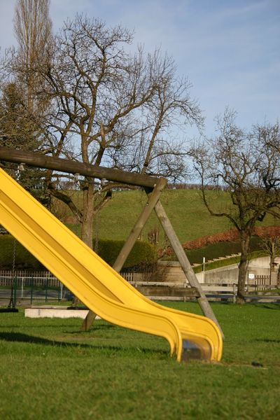 Slide - Play Equipment Playground Outdoor Play Equipment Tree Park - Man Made Space Yellow Grass No People Outdoors Nature Sky Day Playground Equipment Vorchdorf
