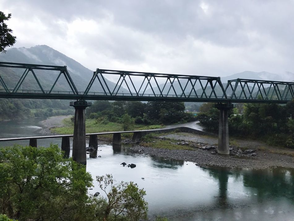 四万十川 高知県 日本 Japan Travel 雨 Rain Rainy Days Connection Bridge - Man Made Structure Architecture Built Structure Sky River Water Reflection Tree Day Engineering Cloud - Sky Outdoors No People Nature Railway Bridge