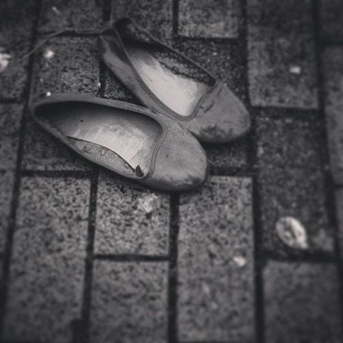 """ Discarded Shoes "" Shoes Discardedshoes Footwear Random Discardeditems Blackandwhite Blackandwhitephotography Bnw Monochrome Monochromatic Pavement Contrast"