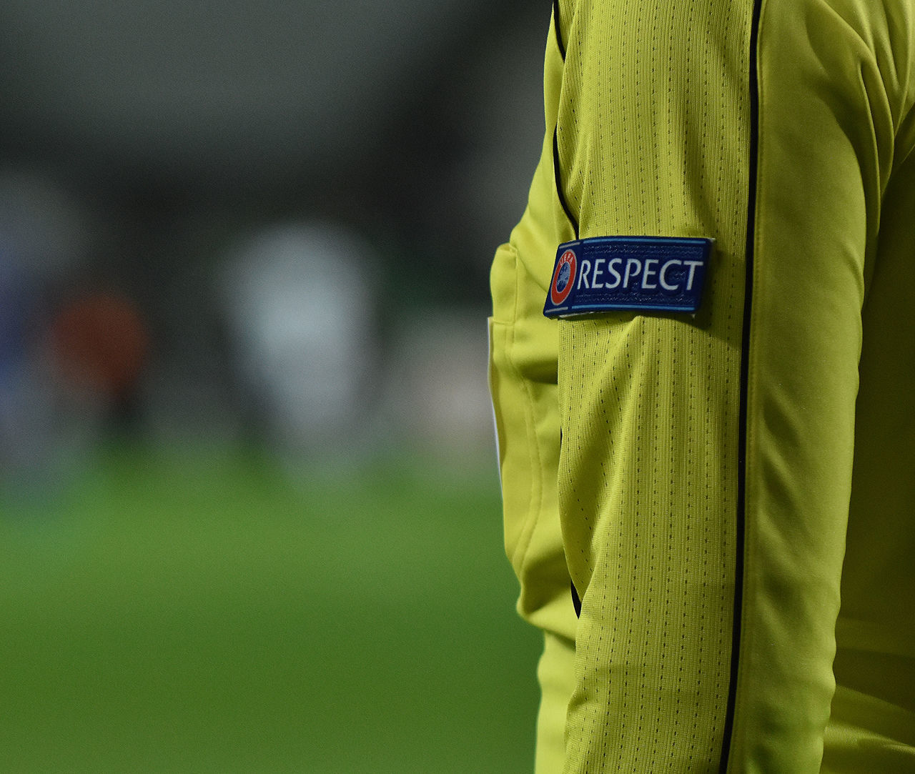 Referee in UEFA Europa League European  Referee Respect UEFA Assistant Referee Close-up Day Focus On Foreground Jacket Match - Sport Men One Person Outdoors Police Uniform Protective Workwear Real People Rear View Safety Standing Uefa Euro League Uniform Be. Ready.
