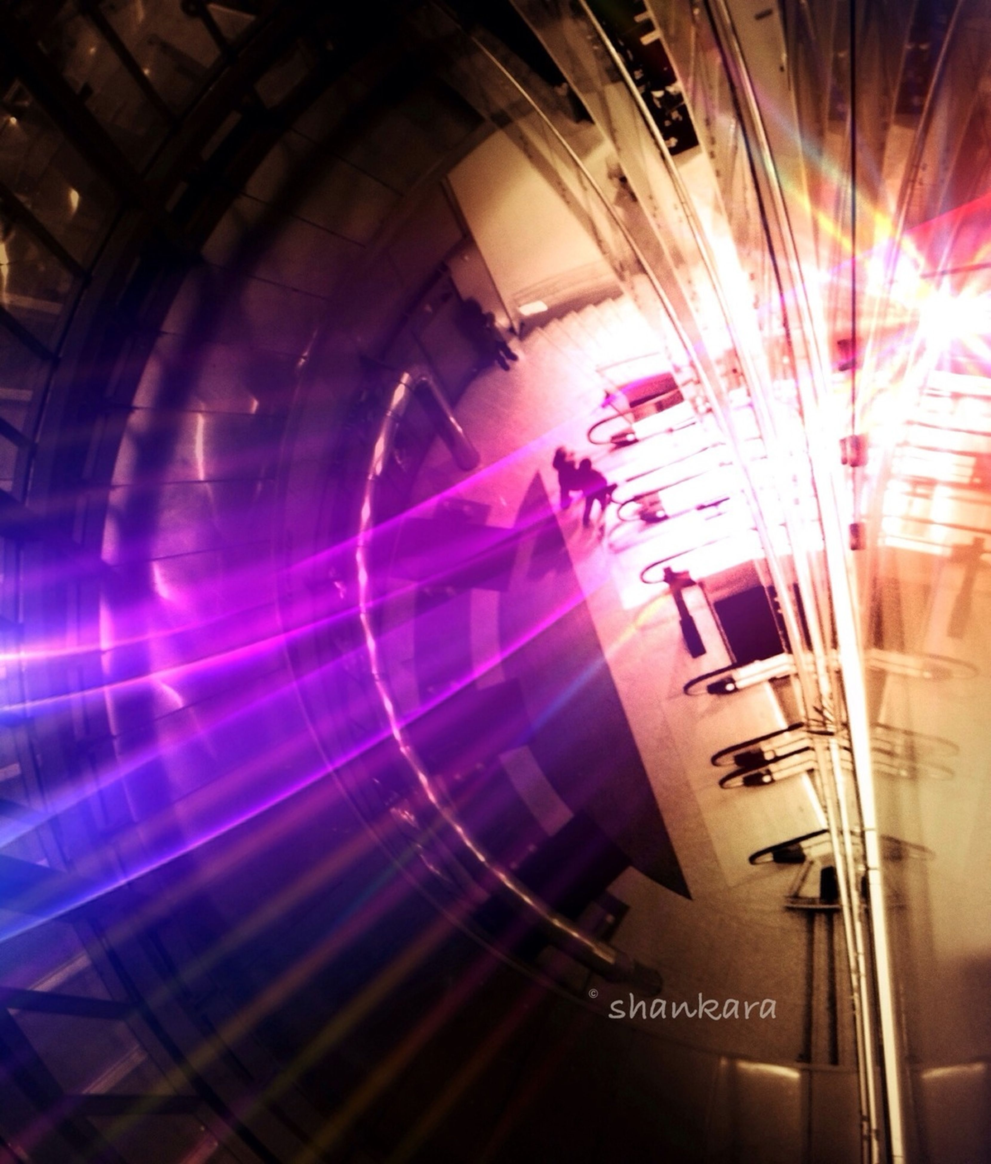 illuminated, blurred motion, long exposure, motion, transportation, night, indoors, speed, lens flare, light - natural phenomenon, light trail, glowing, multi colored, lighting equipment, built structure, architecture, city, on the move, light beam, modern