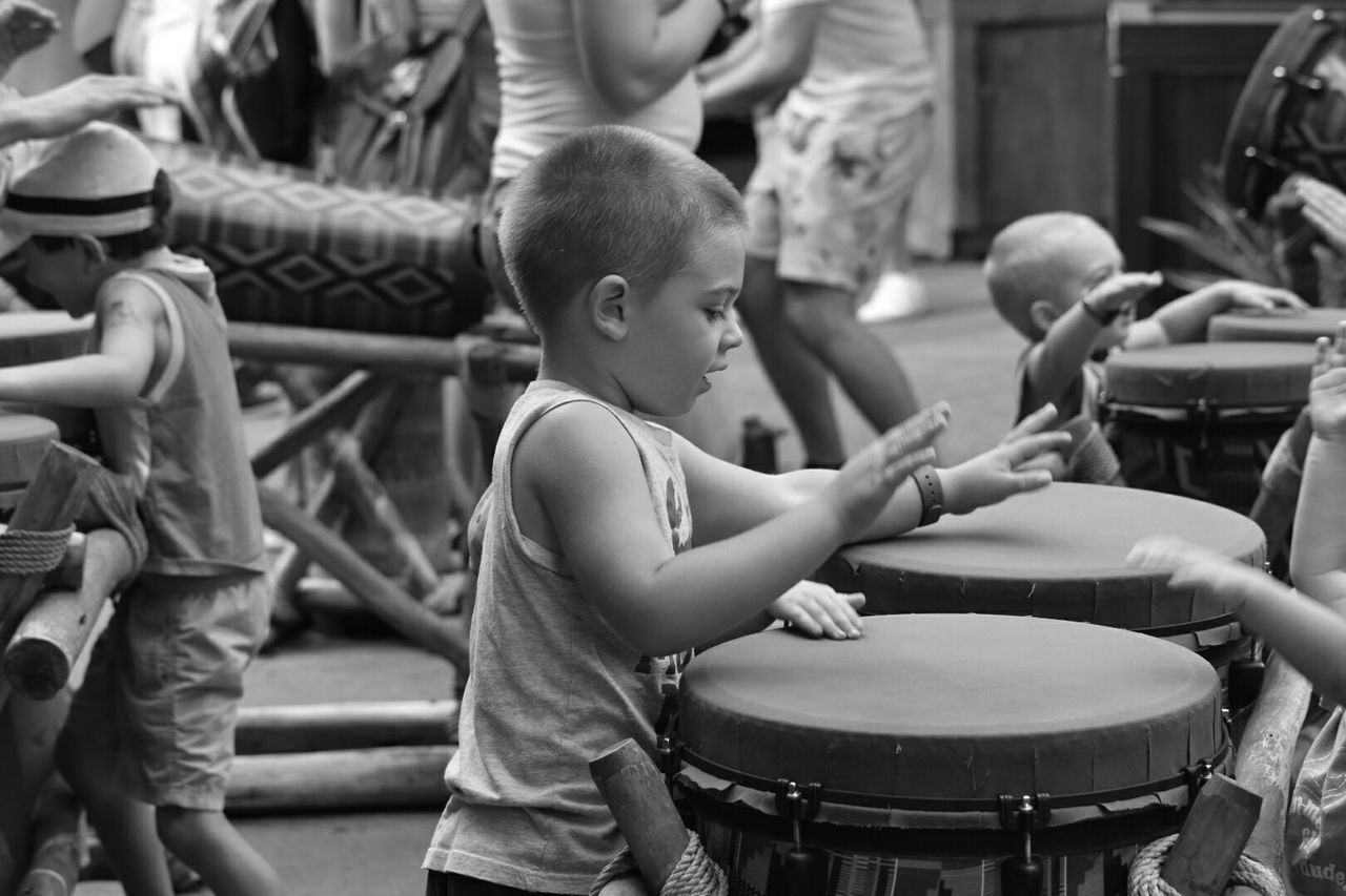 Bangin' on the bongos. Kids Are Awesome Bnw_friday_eyeemchallenge Blackandwhite Black And White Monochrome Kids Being Kids Kids Portrait Children Disney