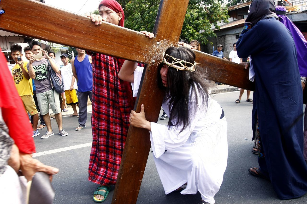 Catholic devotees reenact the suffering or Passion of Christ on Good Friday during the Holy Week celebration. By reenacting and receiving the same suffering as Jesus Christ, these devotees believe that they are cleansed of their sins. ASIA Asian  Catholic Centurion Christian Cross Crown Of Thorns Crucifixion Of Christ Culture Filipino Good Friday Holy Week Jesus Christ Jesus Christ My Savior  Passion Of Christ Philippines Procession Religion Roman Catholic Scourging Semana Santa Senakulo Sins The Photojournalist - 2017 EyeEm Awards Tradition
