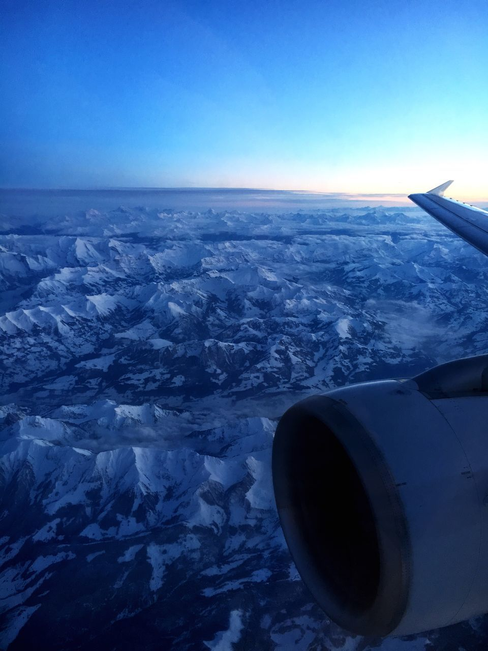 airplane, aerial view, transportation, flying, nature, no people, mid-air, blue, air vehicle, airplane wing, beauty in nature, scenics, aircraft wing, outdoors, sky, journey, day, mode of transport, vehicle part, jet engine, clear sky, sea, landscape, close-up