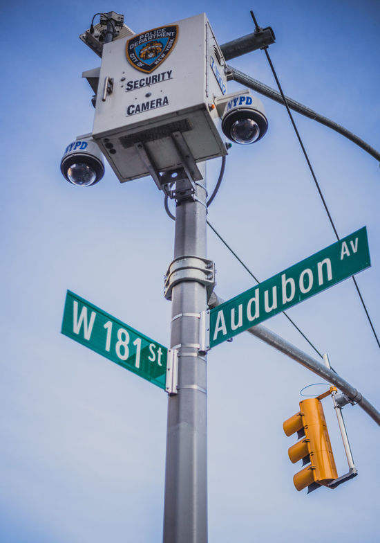 Big brother is watching Audubon Direction Directional Sign Guidance Information Information Sign NYPD Pole Road Sign Sign Symbol Text Warning Sign