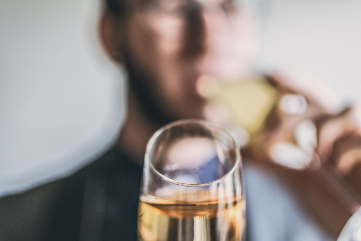 Alcohol Champagne Champagne Flute Close-up Day Drink Drinking Glass Focus On Foreground Food And Drink Freshness Human Hand Indoors  One Person People Real People Refreshment Table Wine Wineglass Women