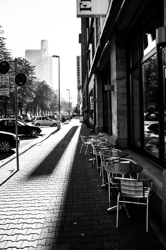 Cafe in contre-jour Architecture Building Exterior Built Structure Cafe Car Chair City City Life City Street Composition Contre-jour Shot Diminishing Perspective Empty Front-light Narrow Pavement Perspective Shadows Sidewalk Street Table The Way Forward