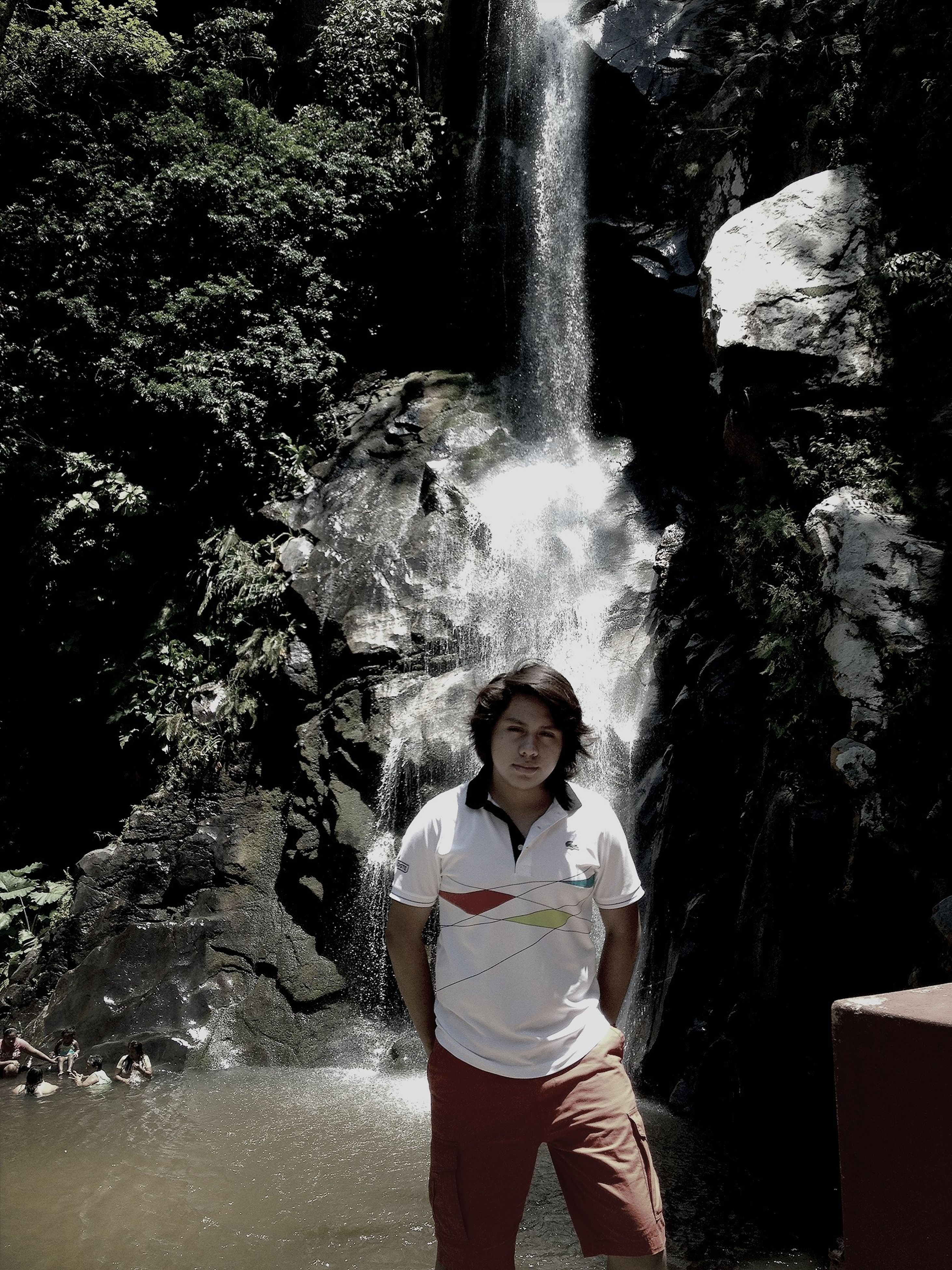 lifestyles, leisure activity, person, casual clothing, standing, water, young adult, portrait, looking at camera, rock - object, young women, front view, smiling, three quarter length, happiness, nature, full length, day