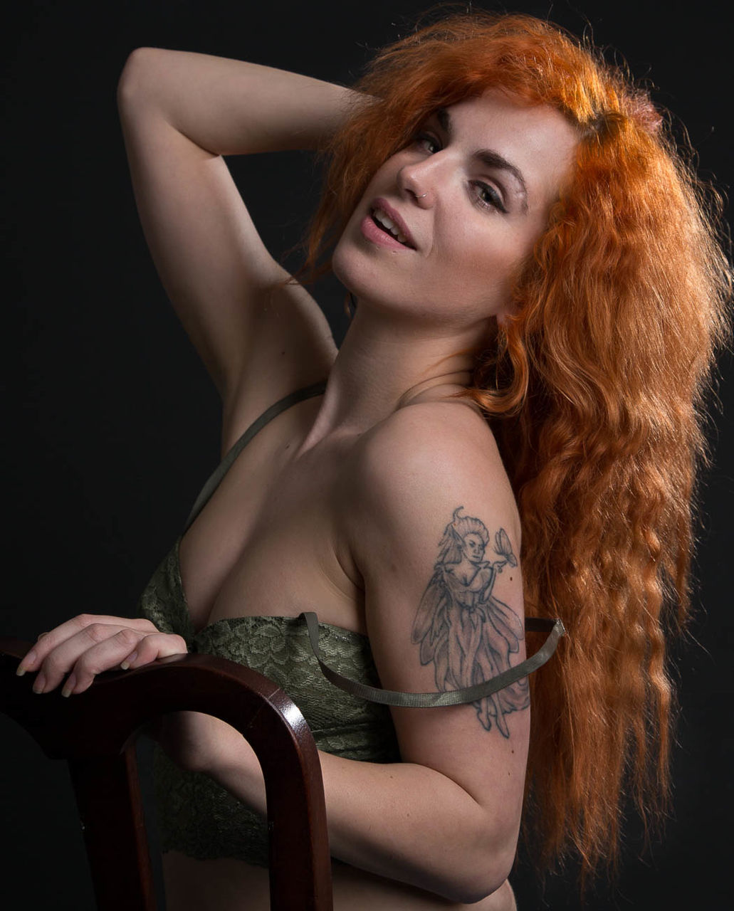 redhead, studio shot, young adult, beautiful woman, one person, young women, real people, black background, shirtless, lifestyles, portrait, medium-length hair, looking at camera, beauty, indoors, close-up, people