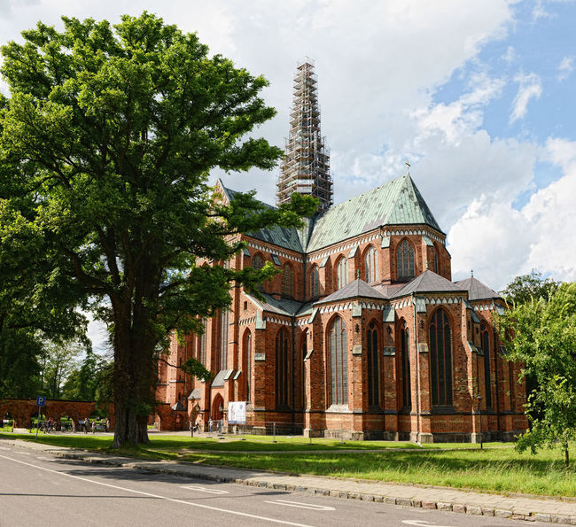 Outside of Doberan Minster (Germany). People walking outside at Bad Doberan Minster in summer time. Architecture Bad Doberan Building Exterior Built Structure Church Cloud Cloud - Sky Cloudy Day Doberan Exterior Façade Nature Outdoors Sky Travel Destinations Tree
