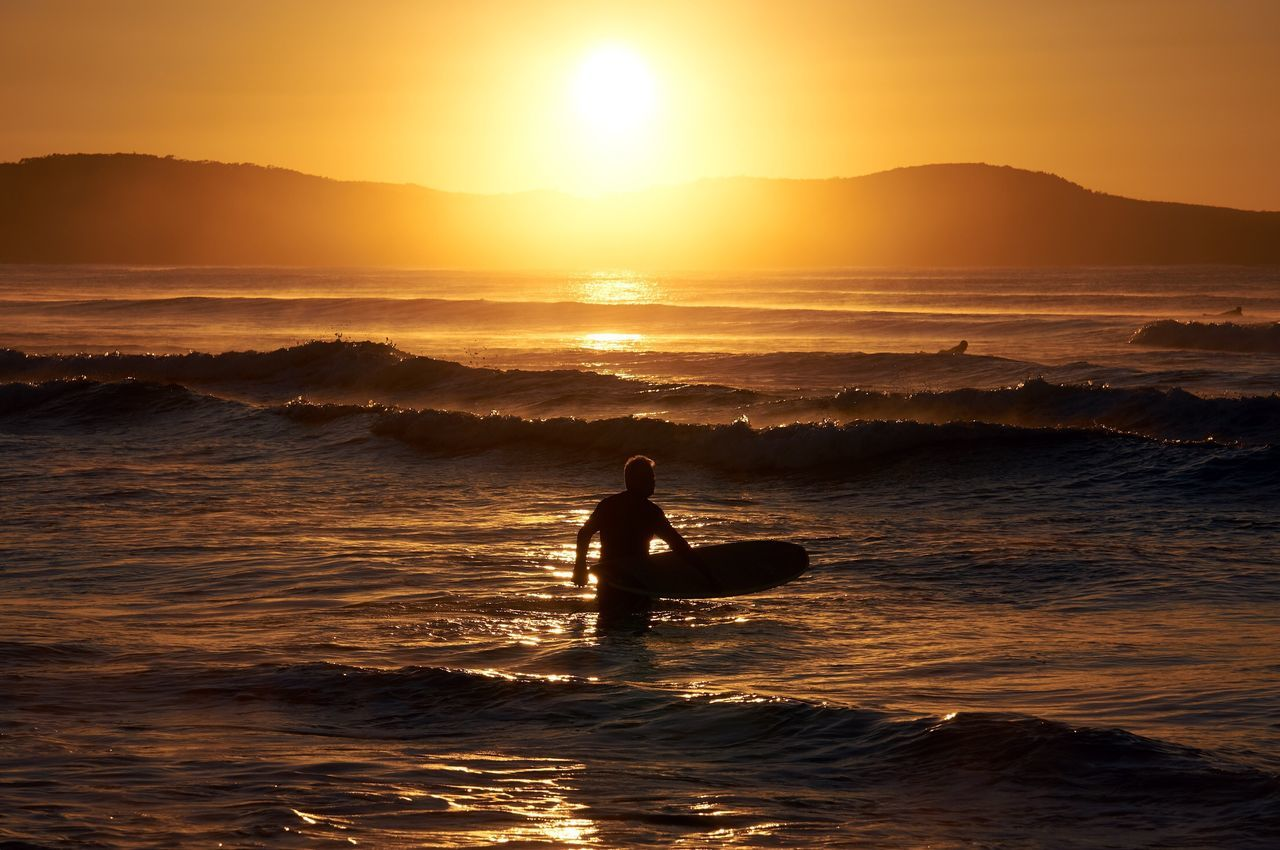 Sunset Silhouette Sea One Person Nature Real People Wave Water Leisure Activity Sky Extreme Sports Adventure Beauty In Nature Scenics Surfing Sun Sport Vacations Men Lifestyles