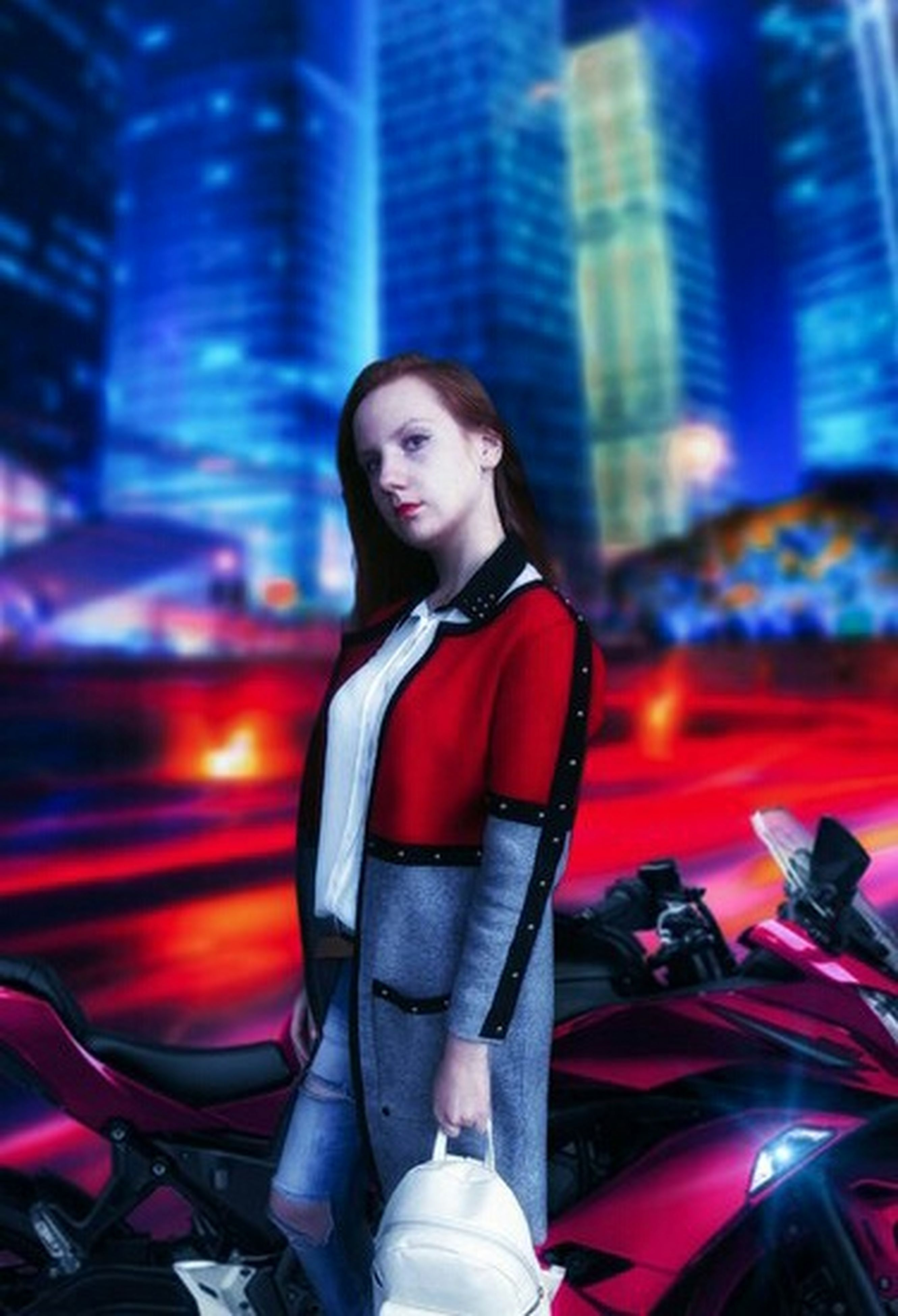 night, young adult, one person, one woman only, adults only, one young woman only, adult, only women, illuminated, city, people, city life, transportation, casual clothing, motorcycle, outdoors, standing, beauty, beautiful woman, young women, beautiful people, portrait, sitting, skyscraper, smiling