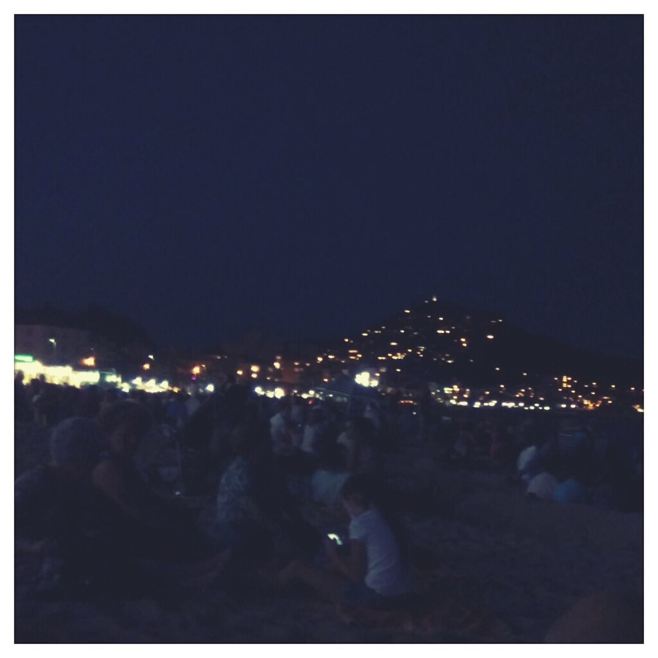 People Waiting For Fireworks By Illuminated Mountain
