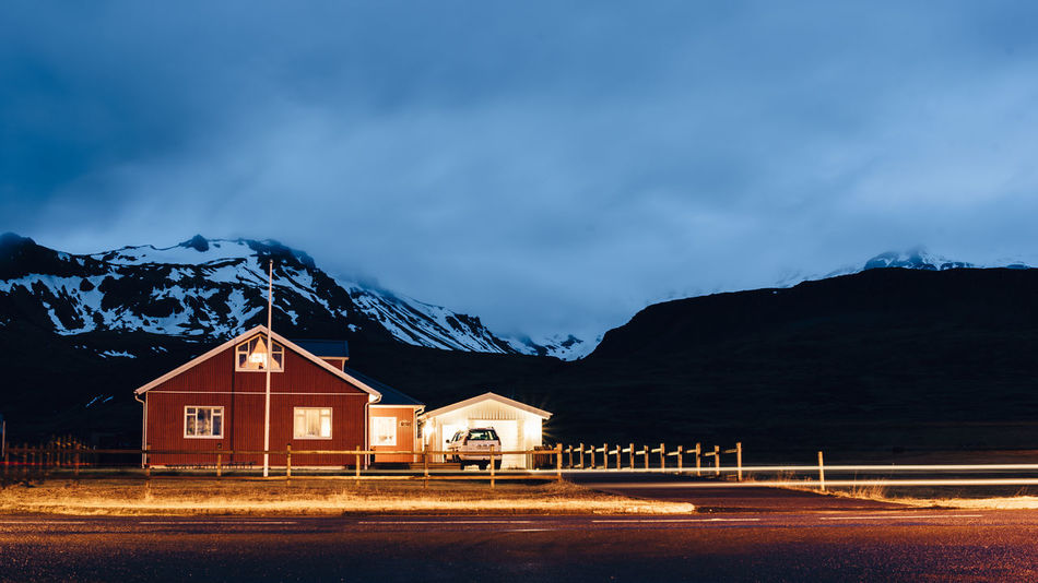 Very Icelandic night Architecture Building Exterior Built Structure Cold Temperature House Iceland Iceland Trip Illuminated Island Mountain Night No People Outdoors Residential Building Snow Star - Space Travel Destinations Winter