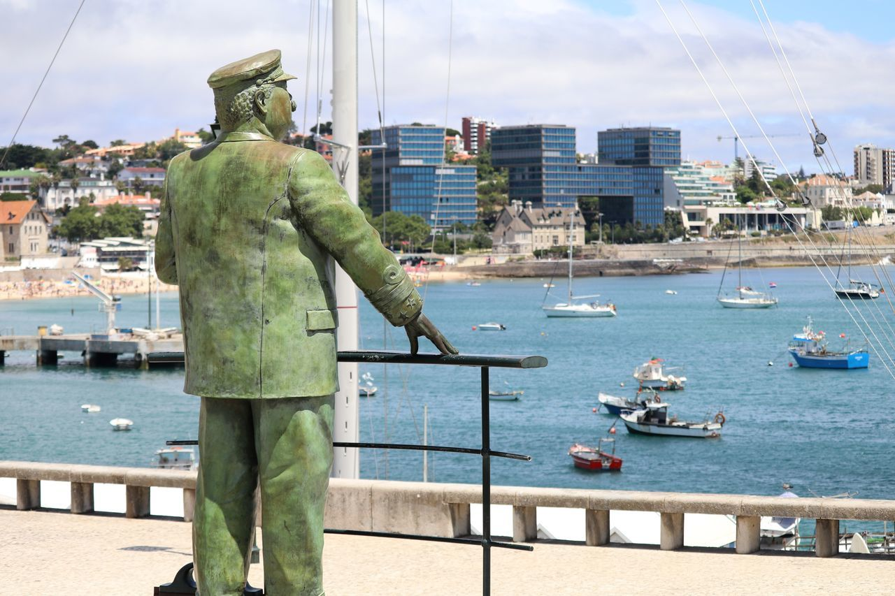 Statue By Sea In City