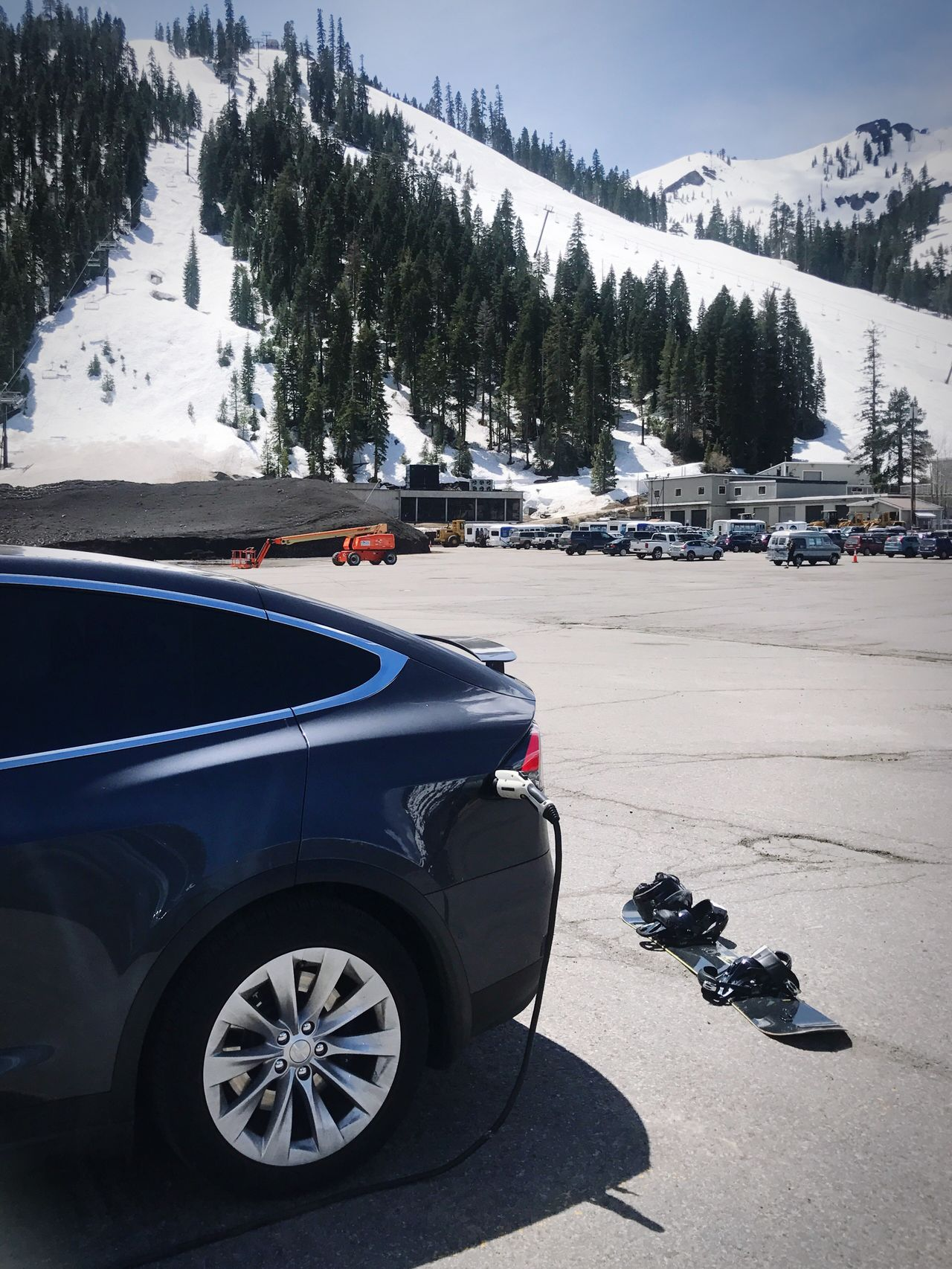 Charging while skiing // Car Transportation Day Land Vehicle Road Outdoors No People Tree Nature Mountain Architecture Sky
