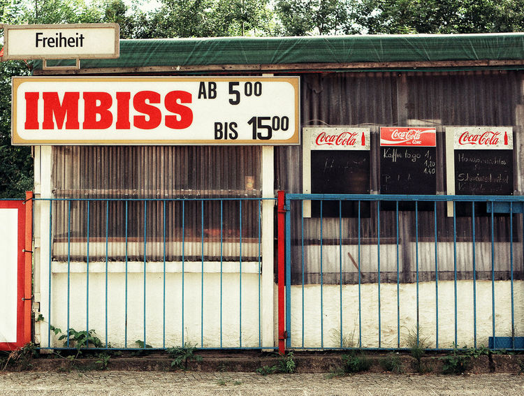 Closed snack shop Abandoned Closed Communication Day Freedom Freiheit History Industry Lonely No People Old Outdoors Shop Snack Shop Text Worker Strassenfilm