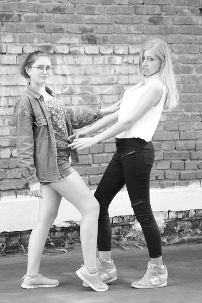 Brick Wall EyeEm Selects Живимоментом Two People People Young Women Standing Only Young Women Friendship Togetherness Portrait Full Length Adult Child Females Beautiful People Looking At Camera Young Adult Beauty Fashion Model Day Student