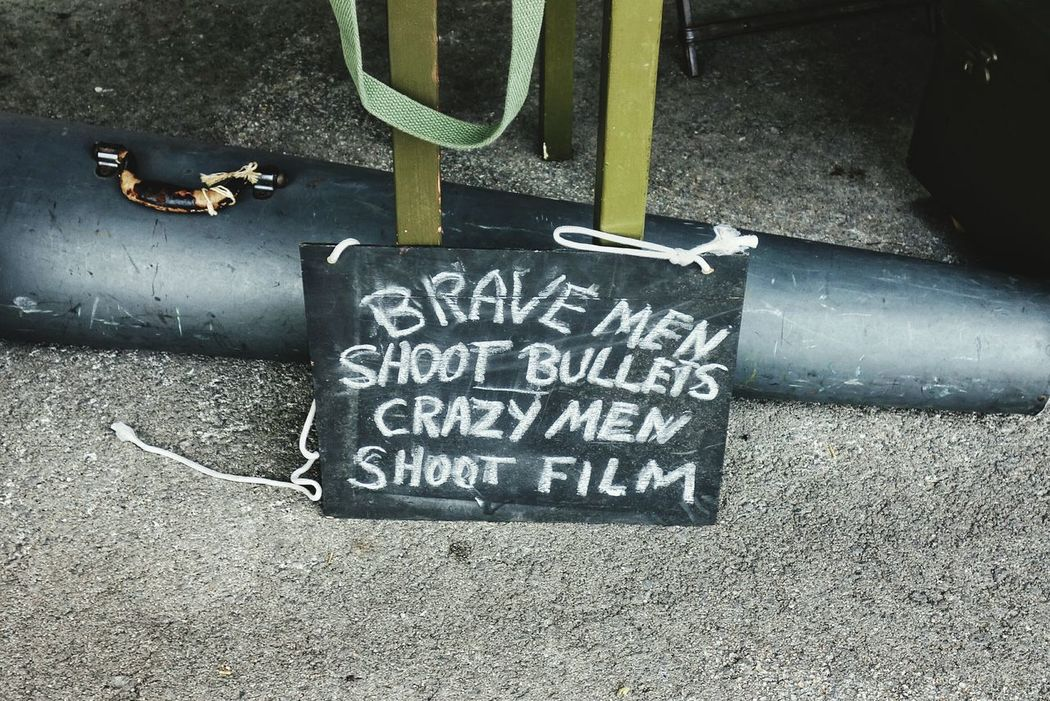 Brave men shoot bullets, crazy men shoot film. Signs Text Photographers Chalk Board Sayings War Photographer