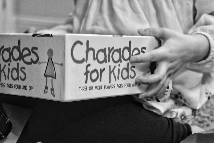 Indoors  Children Game Childrens Game Monochrome Black And White Party Hands Holding Carrying Box Charades Close-up Text People Kids Words Funtime Fun Party Games Communication Day One Person