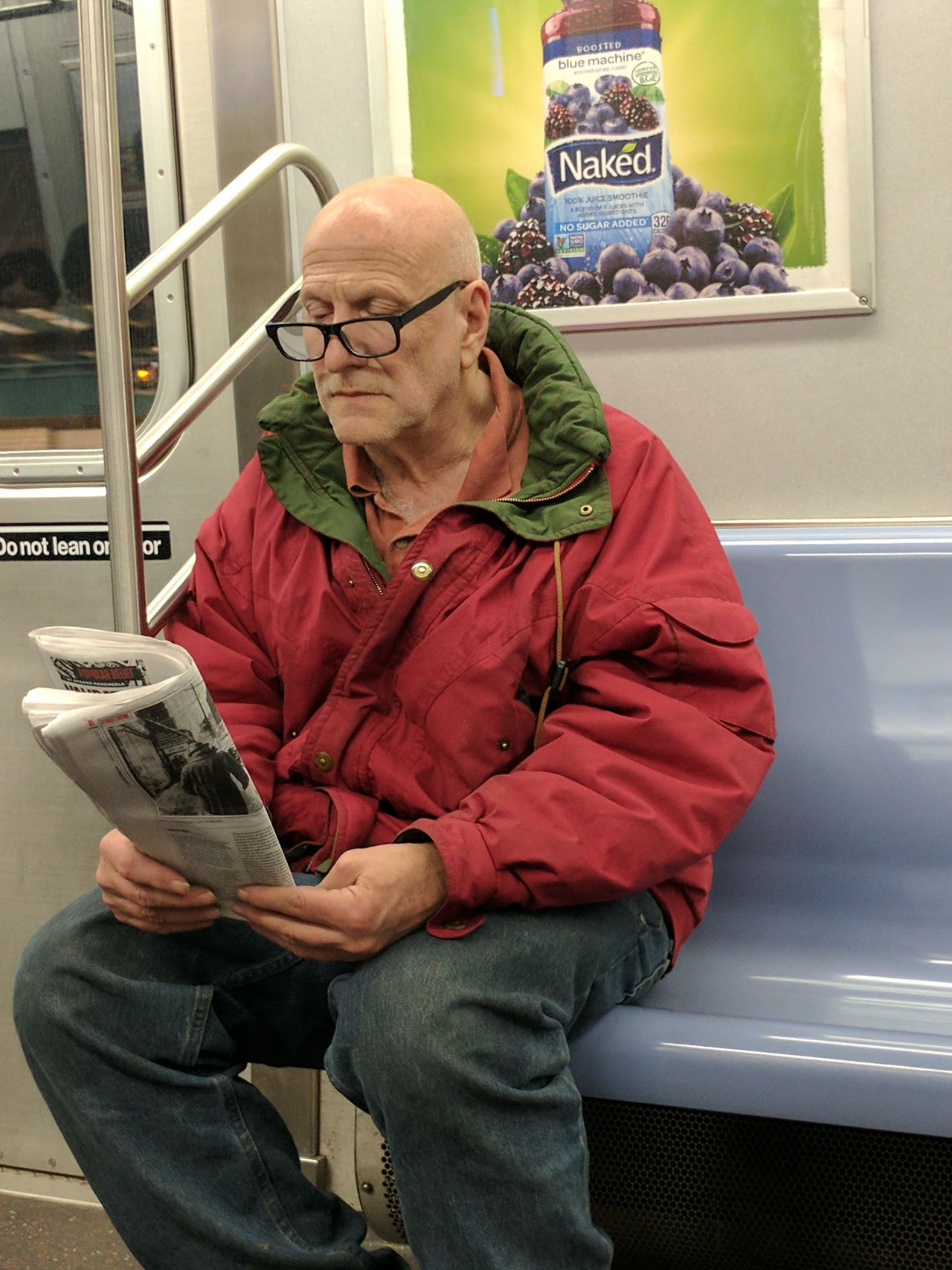 Naked, not naked. Reading on the subway. City Life City Portraits Commuting Eyeglasses  F Train Man New York City Newspaper On The Train One Man Only One Person Portrait Public Transportation Reading Reading The Newspaper Red Jacket Single Person Subway Subway Train Transit