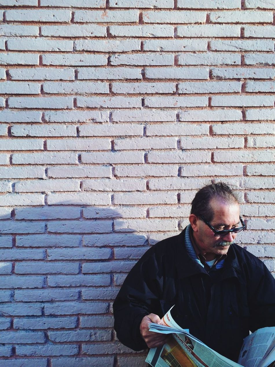 Beautiful stock photos of newspaper, Brick Wall, Day, Glasses, Holding