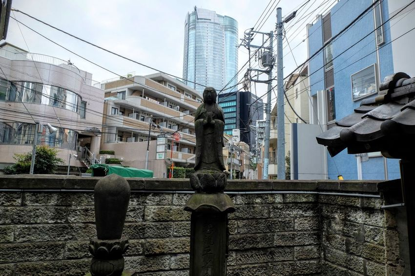 Gritty urban street photography around Shibuya, Tokyo. Buddhism City Dark Dystopian Gritty Realism Religion Saint Shibuya Shrine Statue Street Urban
