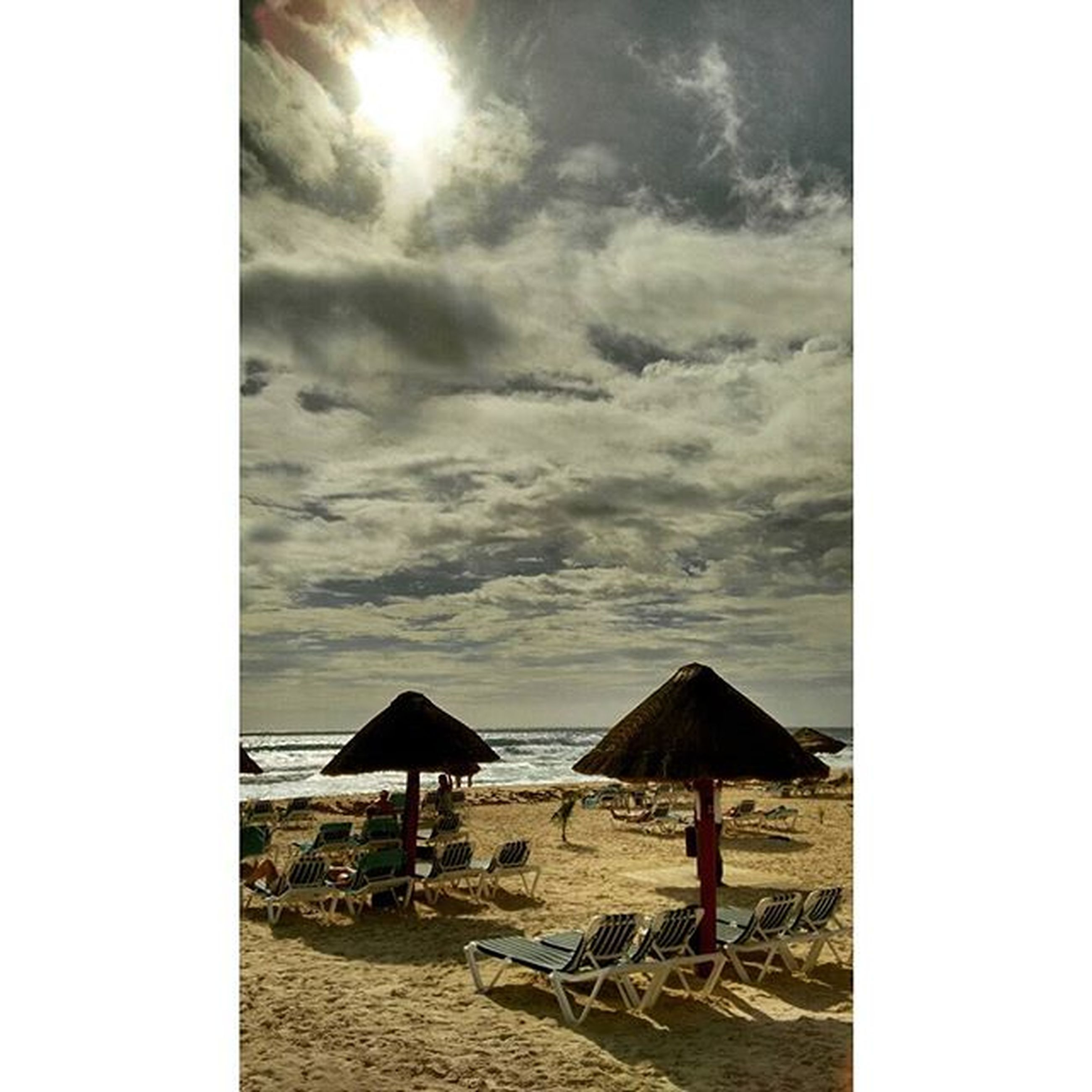 beach, sky, sea, sand, horizon over water, shore, cloud - sky, water, chair, tranquility, tranquil scene, vacations, scenics, sunlight, auto post production filter, nature, transfer print, beauty in nature, lifestyles