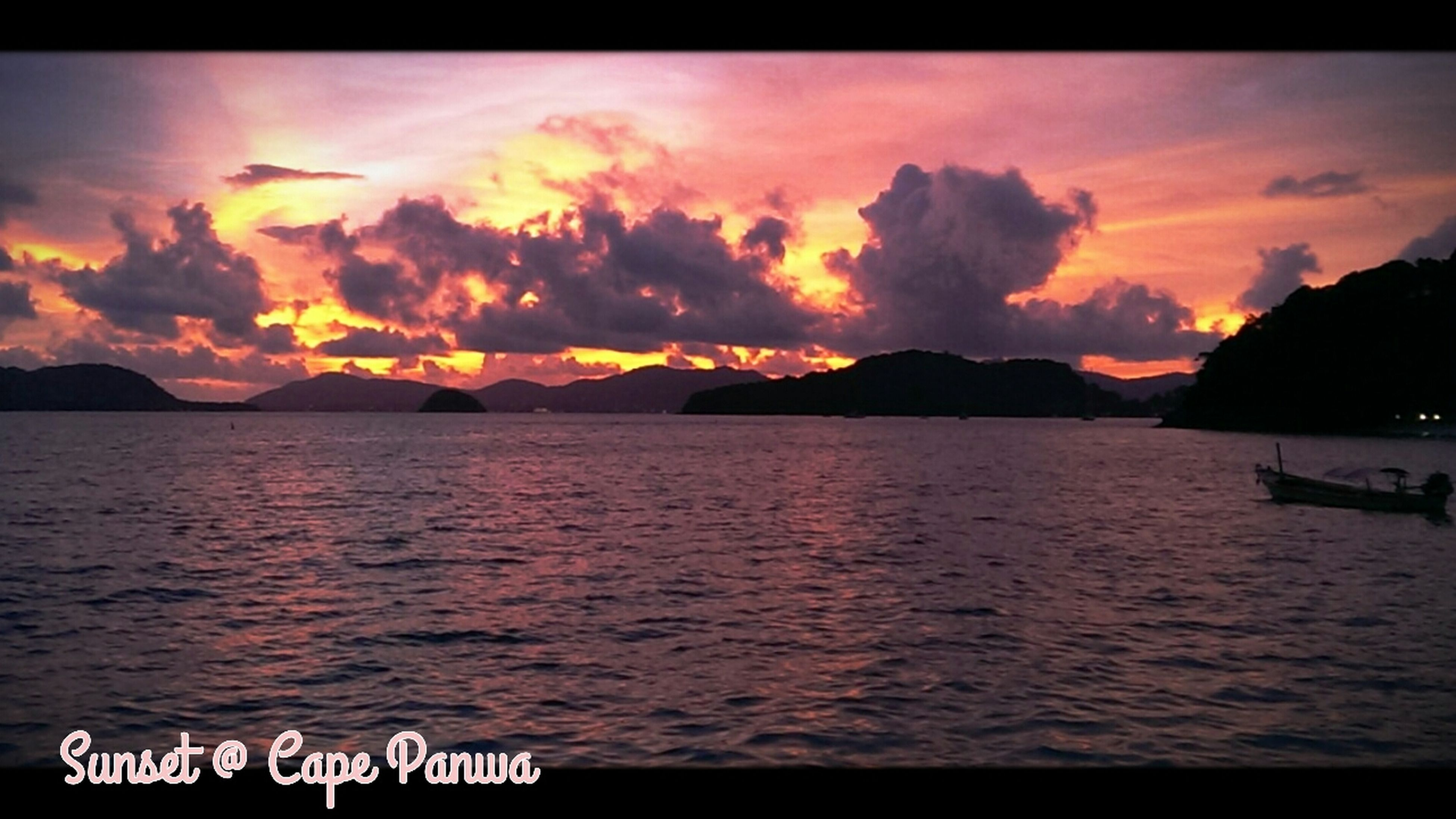 sunset, water, sky, scenics, tranquil scene, beauty in nature, mountain, sea, tranquility, cloud - sky, orange color, nautical vessel, nature, idyllic, cloud, waterfront, silhouette, dramatic sky, mountain range, boat