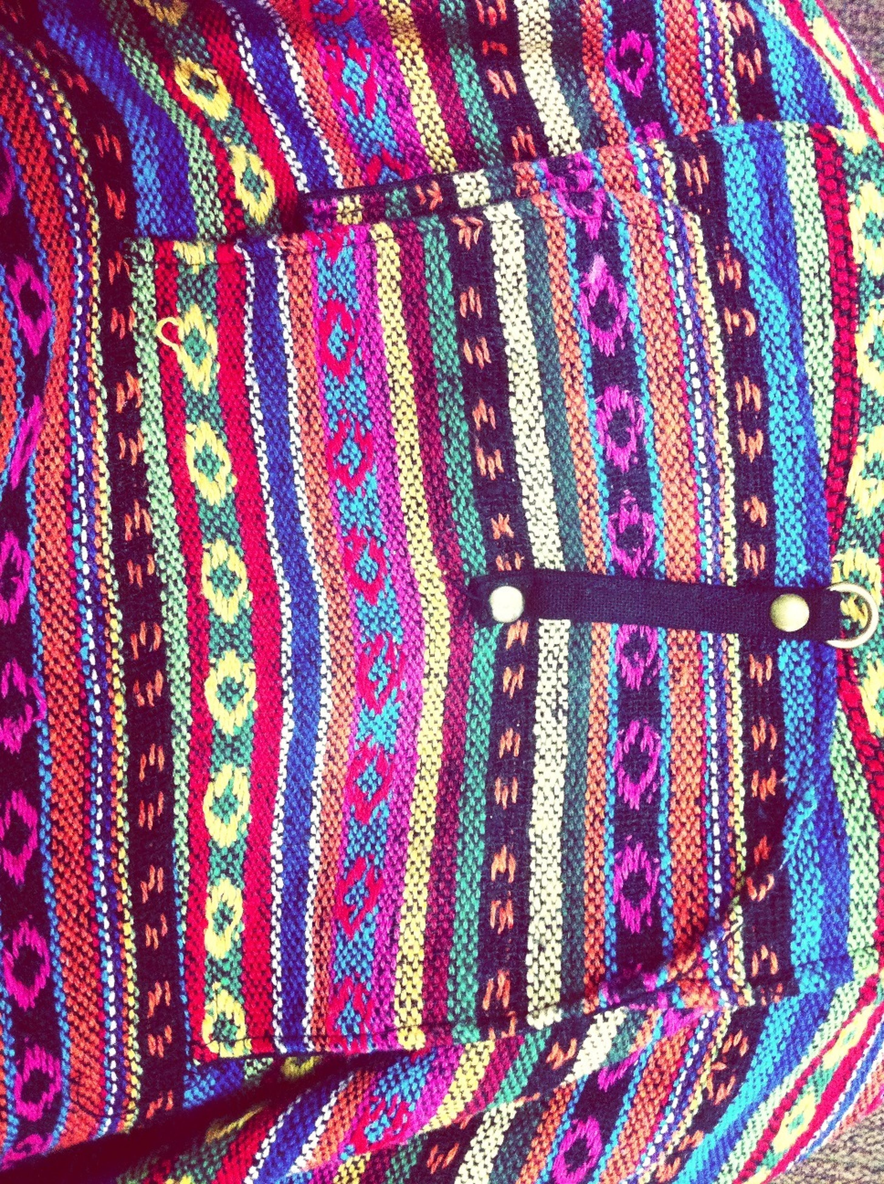 multi colored, textile, indoors, full frame, pattern, fabric, backgrounds, colorful, blue, design, close-up, textured, purple, material, high angle view, variation, art and craft, clothing, floral pattern, no people