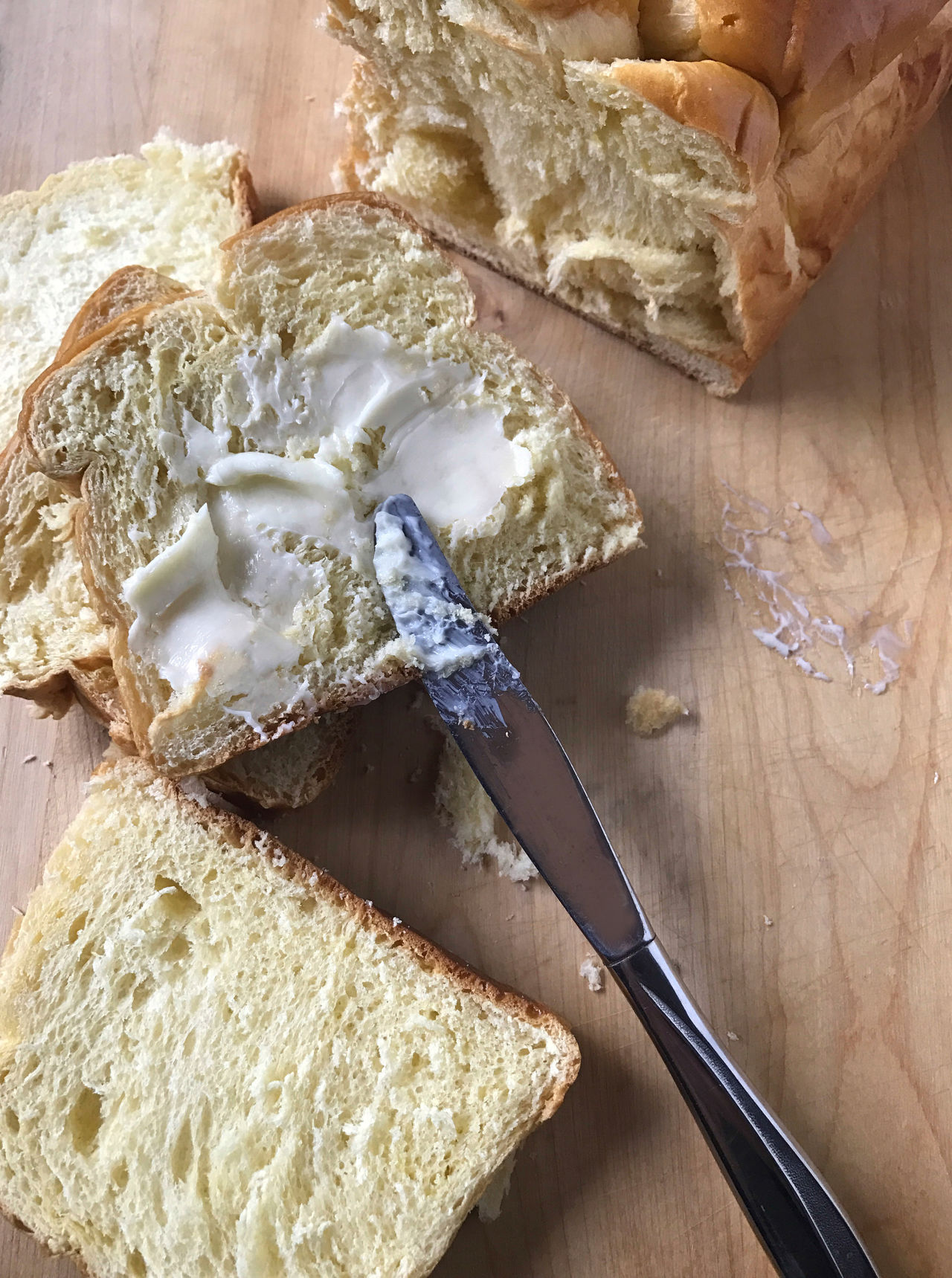 Beige Tones Bread Bread Slices Breakfast Brioche Butter Close-up Cutting Board Day Dinner Knife Food Preparation Indoors  No People Overhead Phone Camera Savory Food Snack Spreading Textures Wood Surface