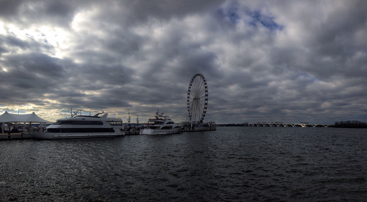 Spots of sunlight filtering through the cold cloudy sky -- visiting Maryland ? ? on a cold ride. The bridge in the distance is how we came and also how we returned Quality Time Hello World Outdoors River River View Potomac River Ferris Wheel Bridge Cycling Around Cycling