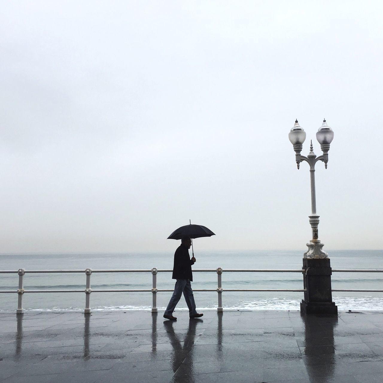 Open Edit Gijón Strideby Umbrella Man Walking Sea Market Bestsellers November 2016