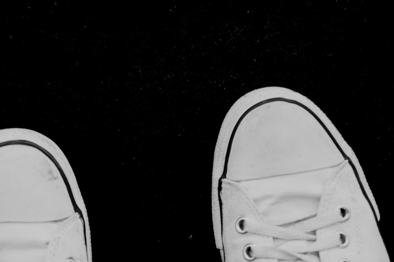 shoe, pair, personal perspective, human leg, one person, low section, canvas shoe, human body part, standing, real people, outdoors, close-up, directly above, night, black background, nature, people