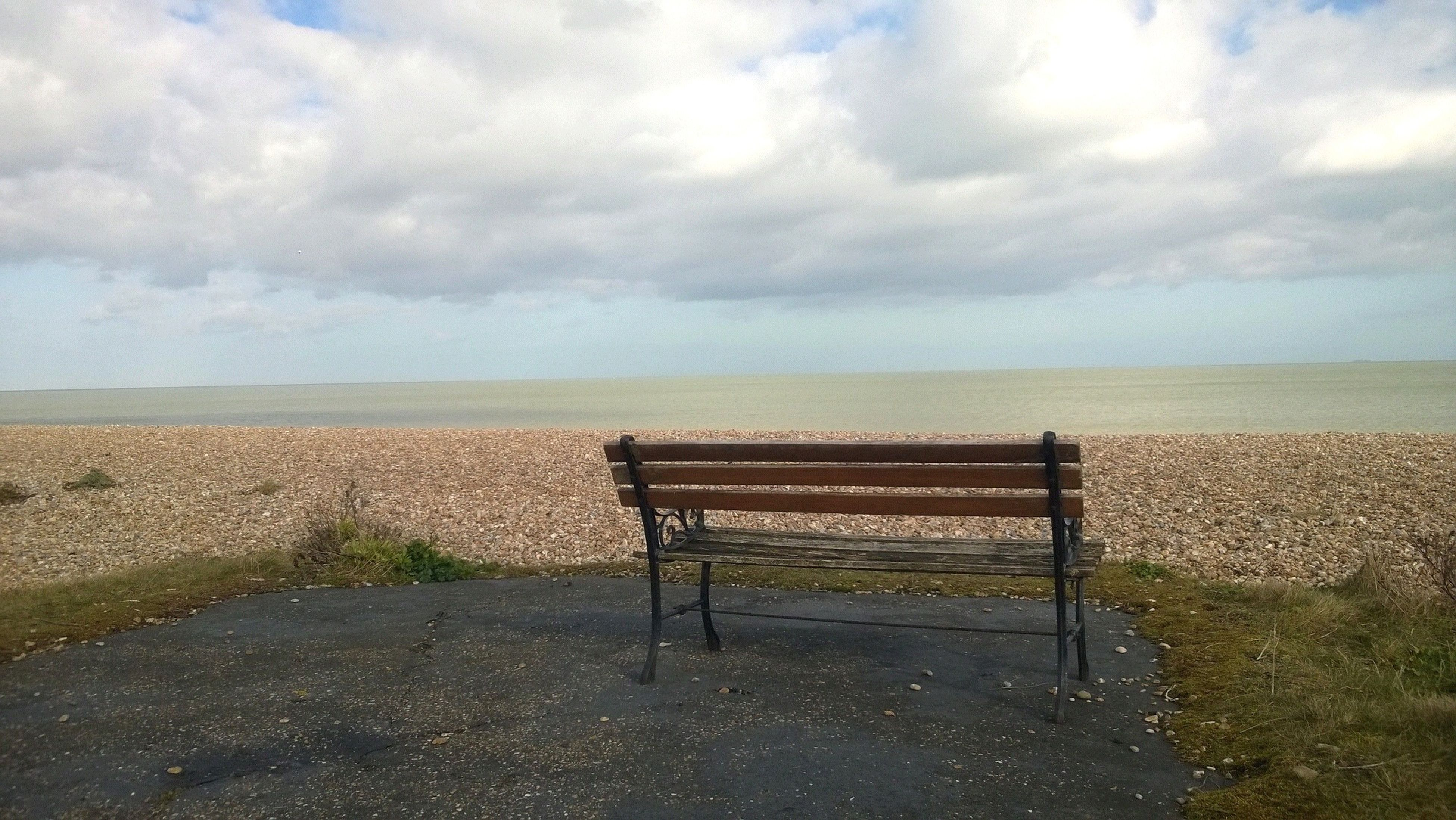 sea, sky, horizon over water, beach, tranquil scene, tranquility, water, scenics, empty, cloud - sky, beauty in nature, nature, shore, sand, absence, cloudy, bench, cloud, idyllic, day